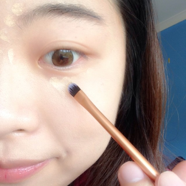Apply concealer onto any flaw you want to cover. Use a detail brush to blend it well. You can use your fingers to tap it.
