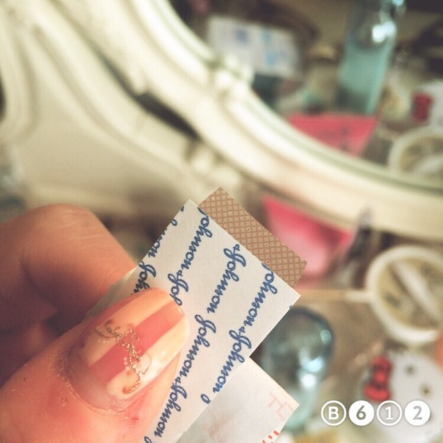 Cut a long and thin piece of adhesive bandage✌