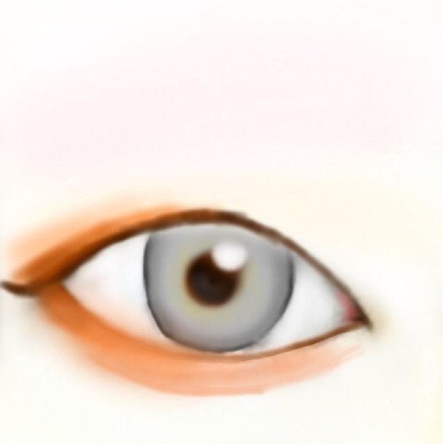 オレンジとブラウンを混ぜたアイシャドウで、まぶたはグラデーションを作るようにして、涙袋は全体的に色を軽くつけていきます