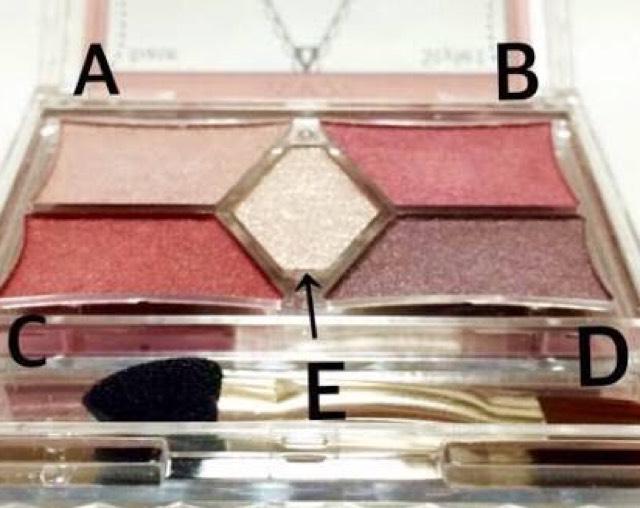 ③スタイリストアイズ14の左下Cを目尻から黒目の真ん中あたりまで、その順番でのばす。目尻が濃くて真ん中は薄くつくように。 下まぶたにも同じように影を指でトントンする。